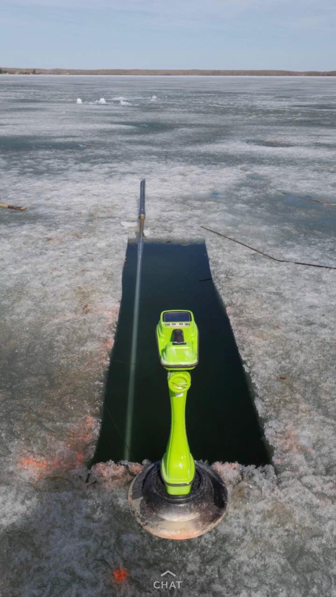 hole cut on frozen lake